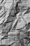 Crumpled checkered paper. macro photo Royalty Free Stock Photos
