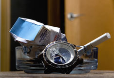The crumpled cigarette pack lies in the ashtray. Royalty Free Stock Images
