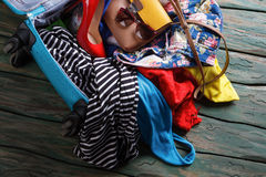 Free Crumpled Clothes In Blue Suitcase. Stock Images - 72607134