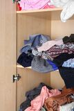 Crumpled clothes on wardrobe shelves,. Closeup Royalty Free Stock Images