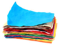 Crumpled color papers Stock Images