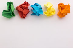 Crumpled colored paper on a white background Royalty Free Stock Image