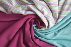 Crumpled colorful fabrics for tailoring. Crumpled jersey fabrics for tailoring royalty free stock photos
