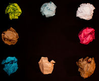 Crumpled colorful paper on black background Royalty Free Stock Image