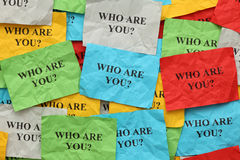 Crumpled colorful paper notes with the question Royalty Free Stock Image