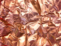 Crumpled Copper Foil. Copper toned foil crumpled and then laid flat to serve as textured metallic background stock photos