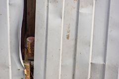 Crumpled corrugated fence. Is close stock photos