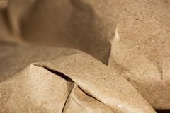 Crumpled craft brown paper background. Is macro stock photo