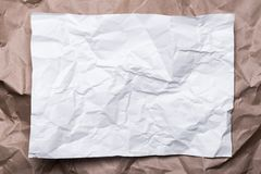 Crumpled cream craft paper like a frame, and white paper, background texture royalty free stock photo