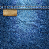 Crumpled denim background with label Stock Photography