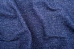 Crumpled denim fabric texture, textile background Stock Photos