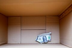 Free Crumpled Dollar Banknote On The Bottom Of Cardboard Box Stock Images - 190797824