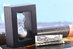 Crumpled Dollar Bill and Hourglass Royalty Free Stock Photography