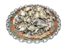 Crumpled dollar surrounded by coins Royalty Free Stock Image