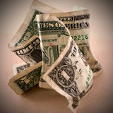 Crumpled dollars. They want to be burnt or thrown out Stock Photography
