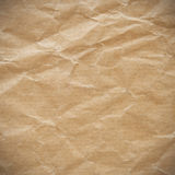Crumpled eco paper texture. Crumpled eco paper background vignette Royalty Free Stock Image