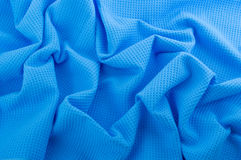Crumpled elegant textured background. Blue fabric as a background Stock Images