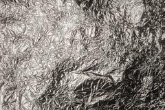 Crumpled enrugou a textura da folha de prata imagem de stock royalty free