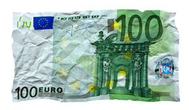 Crumpled 100 euro banknote. Photo of torn crumpled 100 euro banknote front top view isolated on white background Royalty Free Stock Images