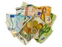 Crumpled Euro banknotes and coins Royalty Free Stock Images