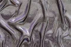 Crumpled fabric of motley iridescent colors Stock Photography