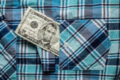 Crumpled five dollars Stock Images
