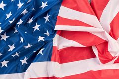 Crumpled flag of USA close up. American national flag as background royalty free stock images