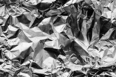 Crumpled foil. Silver crumpled aluminium foil texture stock image