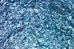 Crumpled foil, abstract background. Crumpled foil as an abstract background royalty free stock photography