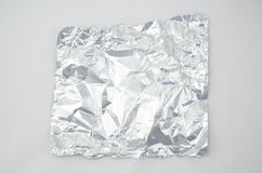 Crumpled Foil. On white background royalty free stock photo