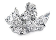 Crumpled foil. On white background stock photos