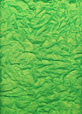 Crumpled and folded bright green tissue paper. Great for backgrounds Stock Image