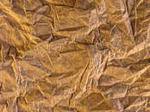 Crumpled Gold. Paper Background Stock Photo