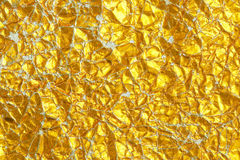 crumpled gold foil paper Stock Images