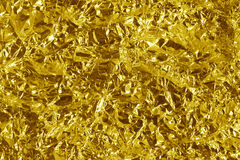 Crumpled gold metal stock photography