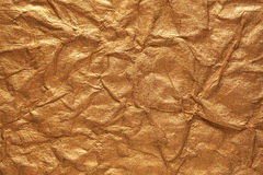 Crumpled gold paper stock images