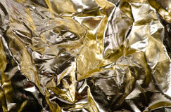 Crumpled golden foil Royalty Free Stock Photos