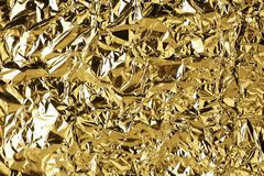 Crumpled golden foil shining texture background, bright shiny gold luxury design, metallic glitter surface. Holiday decoration backdrop concept, gold metal royalty free stock photography
