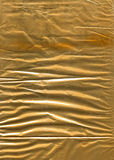 Crumpled golden wrapping paper Royalty Free Stock Photo