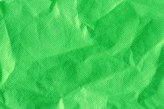 Crumpled green cloth. Green coloured cloth or paper surface Royalty Free Stock Image