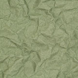 Crumpled green paper with blotches Royalty Free Stock Photo