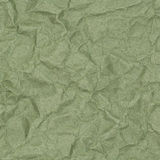 Crumpled green paper with blotches Stock Images