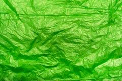 Crumpled green plastic bag Stock Image