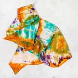 Crumpled hand painted scarf on concrete plate Stock Photography