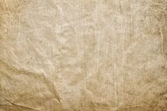 Crumpled paper sheet - background or texture royalty free stock photography