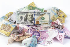 Crumpled hryvnia and one hundred dollars Royalty Free Stock Images