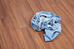 Crumpled Jeans on Floor Stock Image