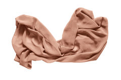 Crumpled kerchief isolated. Crumpled silk beige kerchief on white background royalty free stock image