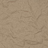Crumpled kraft paper with blotches Stock Images