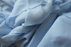 Crumpled light blue polyester chiffon fabric Royalty Free Stock Images